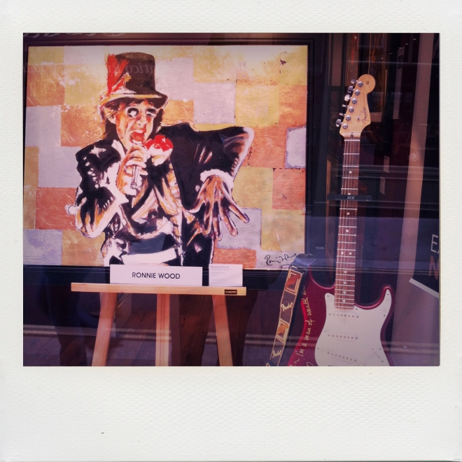 "Ronnie Wood painting of Mick Jagger and hand-lettered guitar (words from ""Sympathy For The Devil"")"